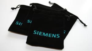 Siemens Münze in Samtbeutel
